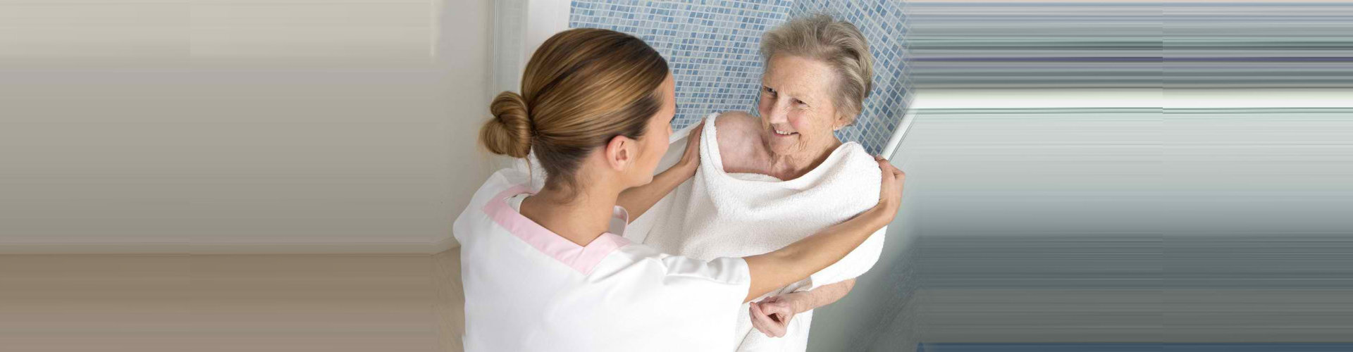 young lady assisting the elderly woman after taking a bath